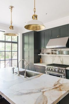 Kitchen Decor kitchen-with-marble-countertop-pendant-lights-green-blue-cabinets-elizabeth-roberts - When a young family—a lawyer and dance professor and their two young sons—purchased a Brooklyn townhouse, the building had been subdivided into four apartm Classic Kitchen, Timeless Kitchen, Green Cabinets, Dark Cabinets, Upper Cabinets, Shaker Cabinets, Wood Cabinets, White Cupboards, Pantry Cabinets