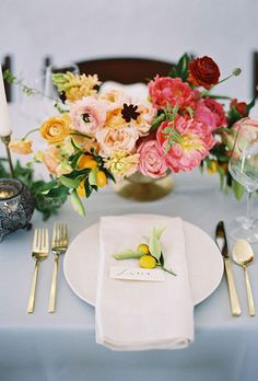 Brides.com: . Delicate miniature lemons are the perfect place card accent at this romantic wedding reception.