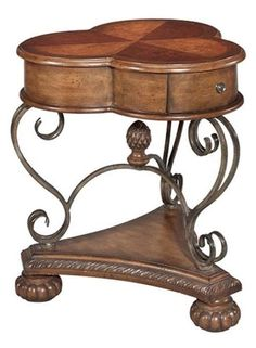 Clover Leaf Accent Table -- For a hint of luck with an Old World feel, an accent piece with a mix of light and dark wood complimented by scroll work iron. | cort.com