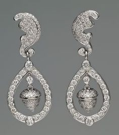 The earrings were commissioned by Mr. and Mrs. Michael Middleton for their daughter on the occasion of her marriage to Prince William. Their design is derived from the acorn and oak leaves that form part of the Middleton family coat of arms and they were also designed to complement the 'Halo' tiara The Duchess wore on the day of her wedding.