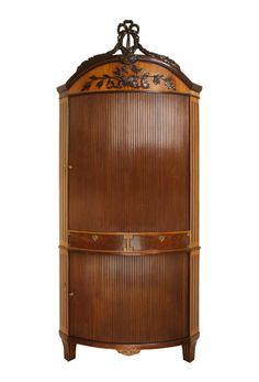 A Dutch Louis Seize Corner Cabinet