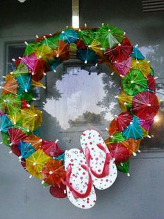 Great wreath for summer. Super easy to make. I took a pool noodle and taped the ends together then I stuck the toothpick umbrellas in the pool noodle randomly. I left a little gap to glue the little flip flops on and that's it