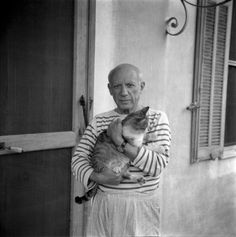Pablo Picasso and his cat in his house in Vallauris, 1954