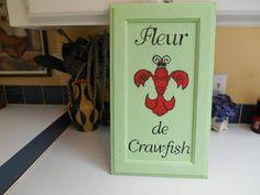 Mardi Gras Fleur de Lis crawfish design painted on cabinet door.