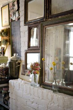 i want a collection of vintage mirrors and large picture frames covering one of my exposed brick walls