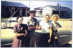 Buddy Holly (2nd from right) with his parents and a friend. Early 50s.