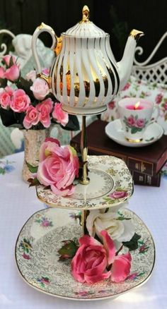 A Mad Tea Party vintage cake stand. A quirky centre piece topped with a mini vintage Sadler gold teapot.