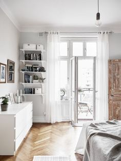 IKEA Malm dresser and simple shelves. Nordic bedroom storage ideas