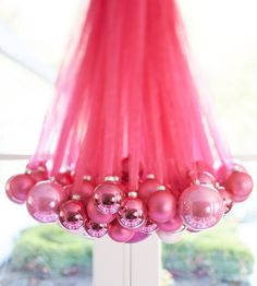 PINK Christmas balls hung with pink ribbon/tulle!!! DIY chandelier: use a single pendant light bulb, then tie ribbons with pretty ornaments of varying sizes attached.