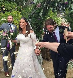Fifi looked elegant in a white lace bridal gown and veil, while her smiling new husband held her hand