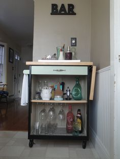 "An old ""microwave cart"" revamped into a mini bar. I just took the doors off, repainted, and added cute scrap booking paper to the shelves. Cool Furniture, Modern Furniture, Furniture Ideas, Broom And Dustpan, Serving Cart, Modern Contemporary Homes, Repurposed Items, Diy Projects To Try, Home Decor Items"