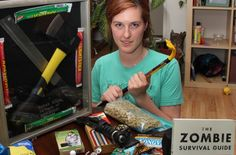 """Zombie Survivalist Group founder Jayme Nelson is seen with the contents of her """"bug-out bag,"""" which she keeps packed in the event of a zombie apocalypse. It includes items like a passport, flares, goggles, a crowbar and clothing."""