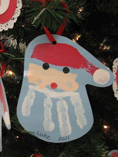 Chirstmas craft idea for kids. Paint and handprint to make Santa.