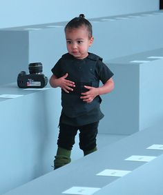 it's a toddler in a bullet proof vest..? why?!