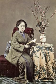 """ Woman posing with a book. ca. 1880s, Japan. Hand-colored photo """