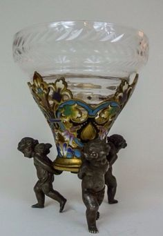 "A 19th century gilt bronze and Champleve enamel vase, with Baccarat glass insert , 8"" high .Estimate $800-1.000"