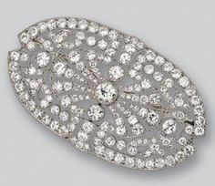DIAMOND BROOCH, FRENCH, CIRCA 1915. The oblong-shaped plaque pierced with stylized palmettes, set in the center with an old European-cut diamond weighing approximately 1.20 carats, completed by 166 old European-cut and single-cut diamonds weighing approximately 15.25 carats, mounted in platinum, French assay mark.