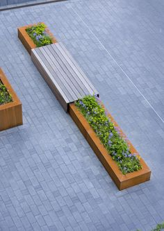 Wall planter with integrated bench. Would anchor Pergola posts visually if we extend off the deck