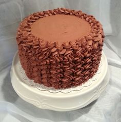 Chocolate layer cake w/ cream cheese filling, chocolate BC piped with 2D tip