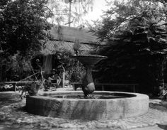 The peaceful courtyard of the Avila Adobe on Olvera Street. The Los Angeles Public Library has a couple of dates for this photo: 1928 and 1937.  (Bizarre Los Angeles)