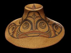 Hat with dogfish design circa 1890 Attributed to Isabella Edenshaw (Kwii.aang), Haida, 1858-1926 and Charles Edenshaw (Charles Edensaw/Tahaygen/Da.axiigang), Haida, 1839-1920 Media/Materials:Spruce root, paint Techniques:Twined, painted Collection History/Provenance:Collected by Lieutenant George T. Emmons (1852-1945, US Navy 1881-1899); purchased by MAI in 1920. Dimensions:41 x 21 cm Cat:9/8015