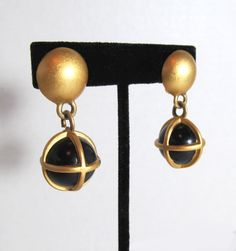 Retro Black and Gold Globe Clip Earrings by MullerGlass on Etsy