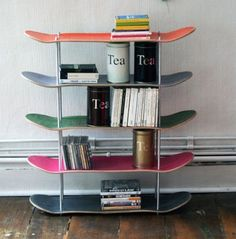 Great use of old skateboards. Shelves for kid's books & video games.  DIY Decor: 5 Projects Using a Skateboard Deck