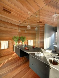 Bathroom - Spacious wrapped in fragrant cedar a spa with a sleek double vanity (re-pinned photo Bates Masi Architects)