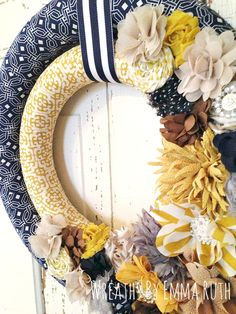 Double Wrapped Fabric Wreath with Modern Navy Blue and Mustard Yellow Prints.  Made by Wreaths By Emma Ruth