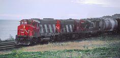 CN 9485 eastbound just west of Port Hope, ON station in October 1980