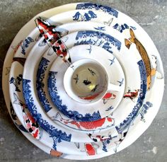 """* Mervyn Gers recently won the Best decorated Award at Ceramics South Africa's Cape Regional with his beautiful Koi and Blue Willow Set. """"A series of plates patterned in decals recalling the familiar Willow Pattern designs and the Koi fish of the East."""