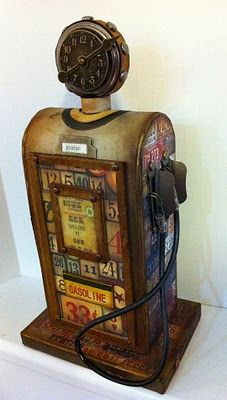 "OMG!! Kathy is amazing. this is from her blog  ""Here are the projects I created for Tim Holtz for CHA.  Vintage Gas Pump - with Mini Matchbook albums inside"""