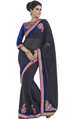 Become an enchanting secret dolled up in this gray embroidered georgette and raw silk sari. Beautified with floral patch, lace, resham and stones work. Upon request we can make round front/back neck and short 6 inches sleeves regular saree blouse also. #LatestNavyBlueJewelNeckSariDesign