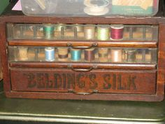 Yummy!!!  Vintage wood advertising sewing spool cabinet!