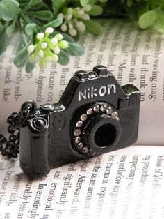 Pretty black nikon camera with white crystals necklace pendant jewelry vintage style (if only it said Canon instead.
