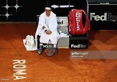 Kei Nishikori of Japan waits whilst Novak Djokovic of Serbia has a medical time…