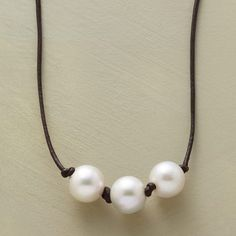 """PEARL TRIO NECKLACE--A handmade pearl trio necklace, simply beautiful, refreshingly modern—just a perfect trio of pearls knotted together on a leather cord. Sterling silver clasp. Handmade in USA for Sundance. 17""""L."""
