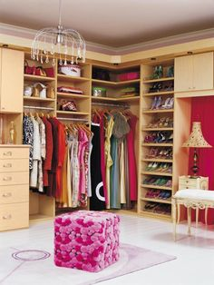 Walk-in closet. Good use of the corner, often a dead space or too small to store much. California Closets (Fairfield 07004)