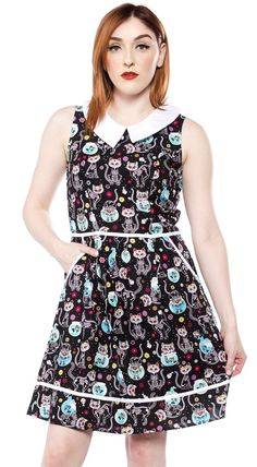 FOLTER MEOW OR NEVER DRESS - You'll be seriously cute in this fabulous feline dress from Folter. The Meow or Never dress features a colorful all over Day of the Dead inspired kitty print, contrast collar, pockets, and zip closure back.