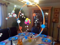 Mad Scientist Birthday Party.  Hanging atom, made with hula hoop, and hanging molecules.