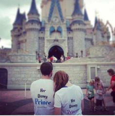Disney couple shirts prince and princess in front of Cinderella's castle.