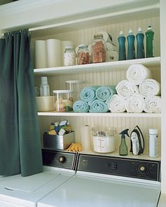 Ok my shelves aren't above the washer and dryer but I like the idea of a curtain.