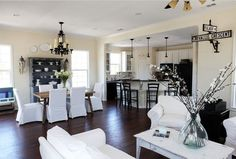 Open concept dining room, kitchen & family room.