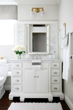 Bathroom design by A Thoughtful Place - mixed metals - clean bright white and grey