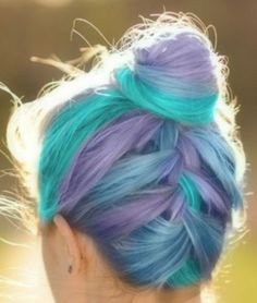 Lavender & Aqua Hair. What do you think?We love the way all of the colors show!  #hair #brighthair #haircolor #purplehair #aqua #hairtrends #braids #topknot #funcolors #fashioncolours #trending