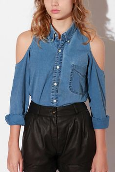 I'm having trouble even looking at it  this. My mind keeps thinking it's two images photoshopped together. The high-waisted leather (pleather? vinyl? what is that, it looks sticky!) shorts aren't helping. (Urban Renewal Cold Shoulder Denim Shirt, Spring 2012)