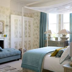 Bedroom Ideas: Bright Bedroom with Built In Cupboard also Floral Wallpaper plus Blue Curtains and Stone Table Lamps