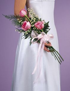 ...and there are different ways of carrying your wedding bouquet. This is an 'arm bouquet', As a celebrant, I would take these from you for your family to hold, or have you pass over to your bridesmaid, before the saying of your vows.
