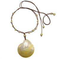Fine Pearls and Leather Jewelry by Designer Wendy Mignot Siren Shell South Sea Gold