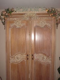 Fancy Romantic shabby chic armoire decorated with garland for Christmas